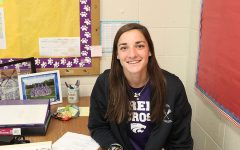 Ms. Melissa Menchella, physical education teacher, sitting at her desk before school, 8/19.