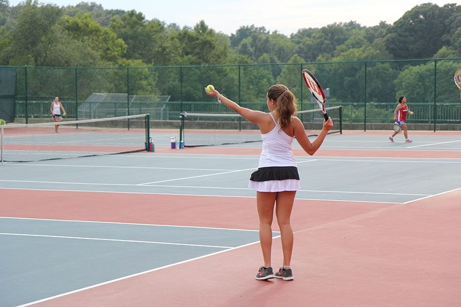 "Emilia Chiriboga, JV tennis, gets ready to serve to her Parkway South Patriot opponent at Parkway South, Aug. 26. ""I started playing tennis this year, and I think it's a lot of fun,"" Chiriboga said. The Wildcats won, 8-7."