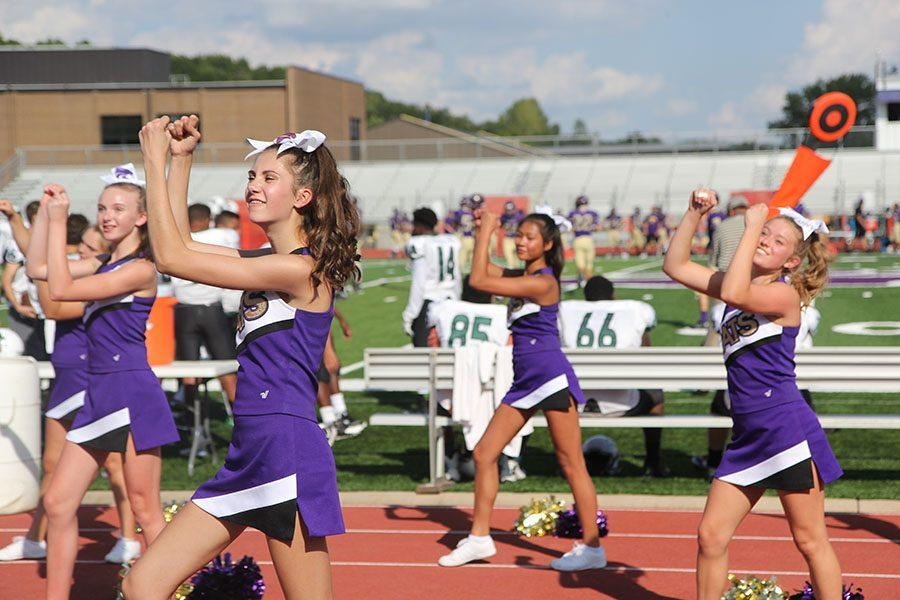 Pumping+up+the+crowd%2C+Madeline+Petry+performs+with+the+rest+of+the+JV+cheer+team+at+the+JV+football+game+against+Pattonville%2C+Sept.+6.+
