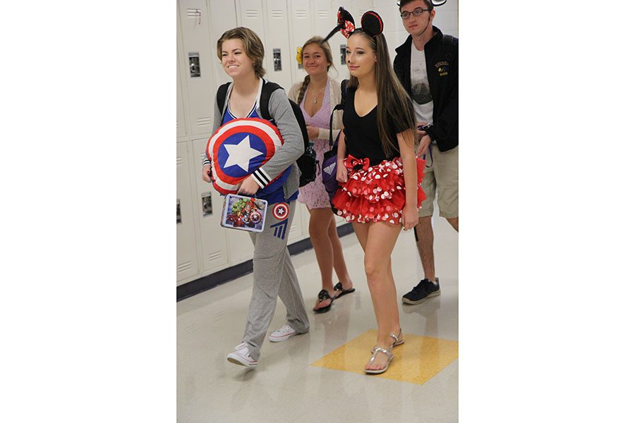 "Captain America and Minnie Mouse meet in the halls as Audrey Rollins and Madison Flower (11) participate in Disney Day, Sept. 27. ""I thought it was pretty cool and funny to dress up and see everybody's costumes and see how all-out everybody else was going,"" Flower said. ""I just thought it was really fun, and it made the week a lot easier."""