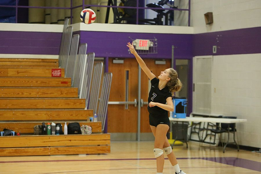 """Her serve strong, Madelyn Murawski, setter, clears the netl during the freshman volleyball game against Fox, Oct. 3. """"I was really proud of everyone,"""" Murawski said. """"We were working good together. Everyone was getting their passes up and were doing really well."""" The Wildcats won, 2-0."""