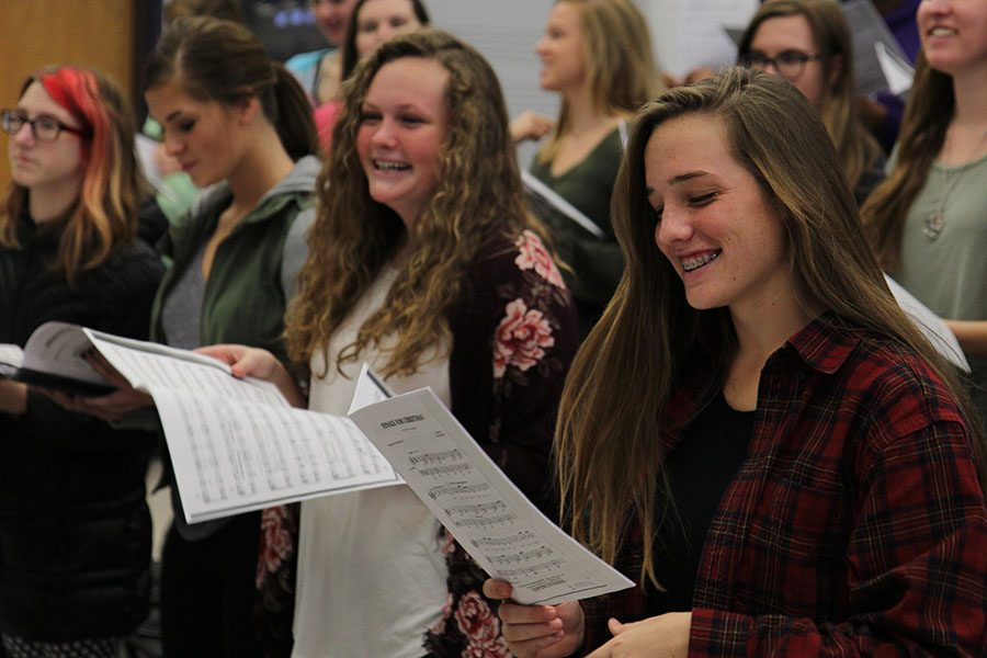 "Moved by the song, Molly Kerr (11) sings a ""Winter's Bone"" in Mr. Charlie Kinnison sixth hour Concert Chorale class, Nov. 15. ""I really enjoy the class,"" Kerr said. ""Mr. Kinnison is a really good teacher. He makes the class really fun by making jokes but also teaches us a lot while doing it."""