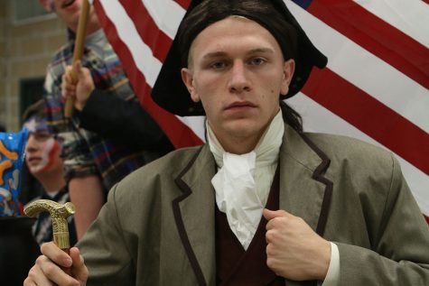 Dressed as a Founding Father, Ryan Giesing (12) attends the journalism STL Trivia Night, Oct. 29, 2015. My friends and I dressed up in as much American clothing as possible for the Halloween-themed event. By the end, we were awarded a cauldron full of candy for having the best-dressed table. As much as I adore the Founding Fathers, the electoral college is one thing that they got wrong.