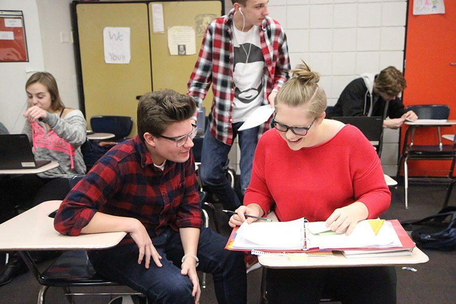 """Jerod Turner (11) and Rachel Cundy (12) work on their set in Mrs. Susie Allmendinger's seventh hour Theatre Design class, Dec. 9. """"The project was very difficult at the time which is why we were both laughing at the time,"""" Turner said. """"We didn't want to take it seriously at the time."""""""