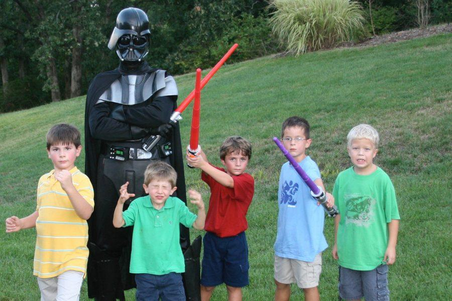 The dark lord of the Sith, Darth Vader (Mike Weaver, my father) poses with me, Jack Weaver, my brother; Dale Manzo, my cousin and my friends Nathan Bauman (12) and Griffin Anderson  at my eighth birthday party, Aug. 26, 2006. Before taking this picture, my mother, Angela Weaver, handed out a variety of light sabers for all of our guests to fight with.