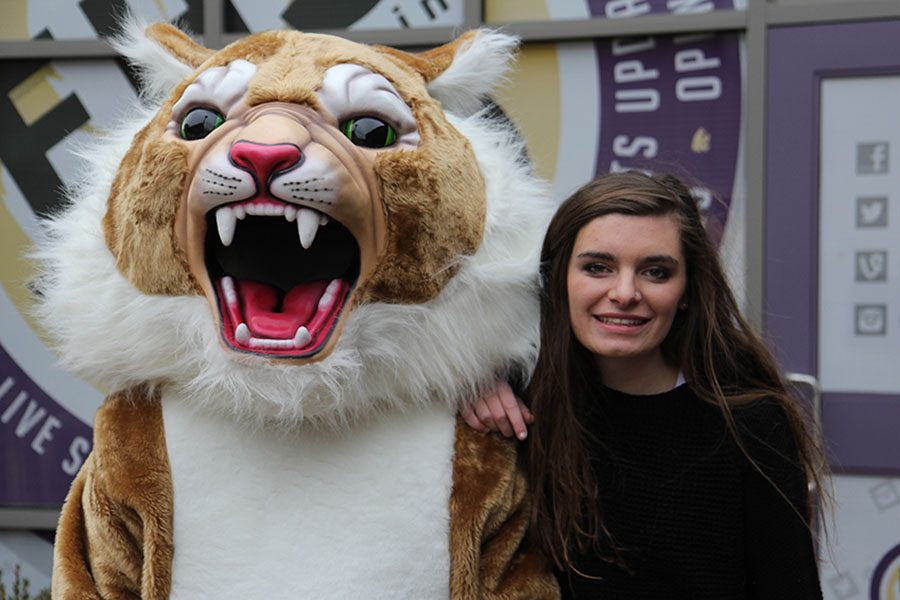 Posing with Wilson the Wildcat, Emily spends one last time as a Eureka Wildcat, Dec. 16.