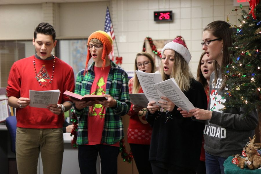 Members of the Eureka Caroling Society perform in a classroom during Festive Holiday Sweater Day, Dec. 16, to bring holiday spirit into the EHS community.