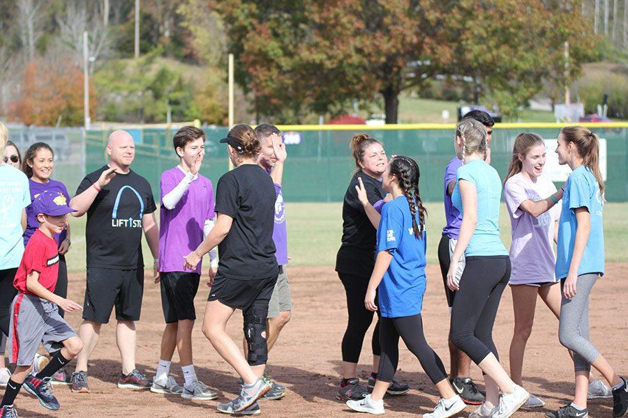 Opposing+teams+congratulate+each+other+on+a+good+game+at+the+Backstoppers+kickball+tournament%2C+Nov.+5.+The+tournament+raised+over+%24800+for+Backstoppers+and+the+family+of+fallen+Officer+Blake+Snyder%2C+who+died+in+the+line+of+duty%2C+Oct.+6.+His+death+reminds+us+of+how+the+recent+police+deaths+in+Israel+hit+close+to+home.