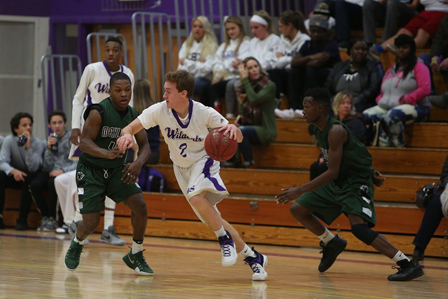 """In a close game, Shane Lockwood Guard looks to score and keep the lead for the Wildcats during the jv basketball game against Mehlville, Jan. 6. """"We played good as a team,"""" Lockwood said. """"At the end of the day that's all that really matters."""" The Wildcats Won."""