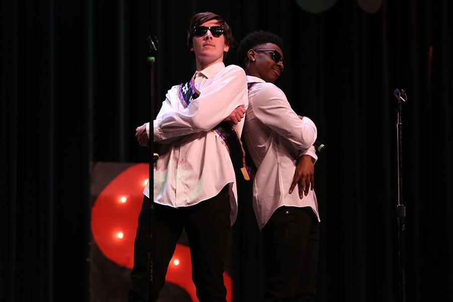 "After a killer karaoke performance, Sam Wingbermuehle, Mr. etc... and Norrim Holder, Mr. Onstage! held an ending pose as they receive a surging round of applause from the audience. Wingbermuehle won runner-up in the Mr. EHS competition. ""I was at a loss for words when I made the top six. I was really excited and overwhelmed at the same time,"" Wingbermuehle said."