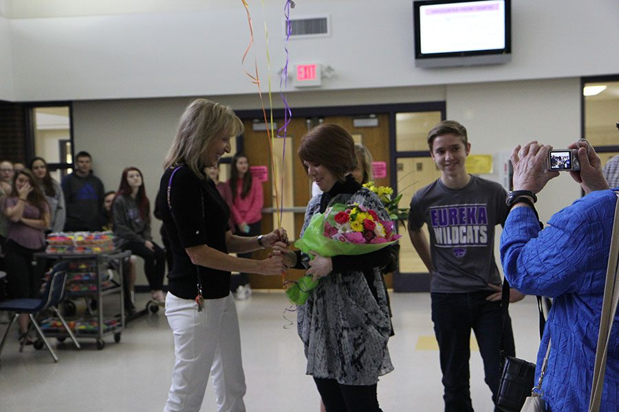Diane Lucas congratulates Robyn Stellhorn, 2017 Teacher if the  Year winner, in the Commons first hour, Feb. 24.