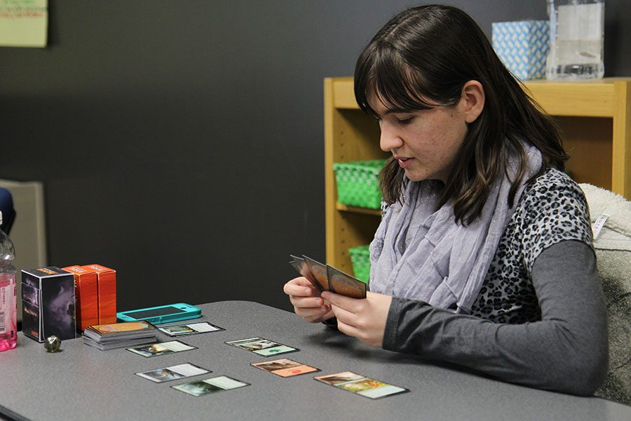 "With a strategy Haley Ozmat (12) plays Magic The Gathering during the magic club meeting, Feb. 2. ""The game involved a lot of strategy but not to much,"" Ozmat said. ""I really enjoy it because I really enjoy strategy."""