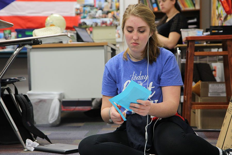 "Raising awareness, Sarah Alvey (11) works on her Spanish 4 project about poverty in Central America during Julie Weitzel's fifth hour class, March 3. ""I thought it was an important issue,"" Alvey said. ""If you can put some steps into place you could end the cycle of poverty."""