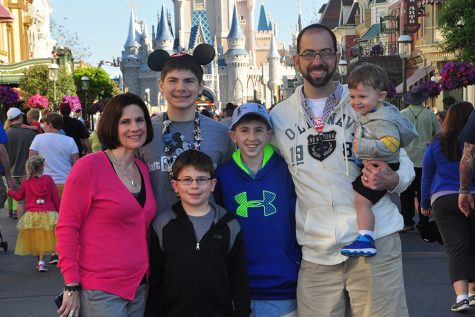 My mom, Angela Weaver, my brothers, Joey and Jack, my dad, Mike Weaver, my baby brother, TJ and I pose in front of the castle on TJ