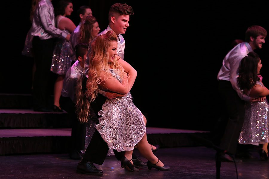 "In their grand finale, Jerod Turner (11) and Angela Busby (12) finish their dance to ""Proud Mary"" by Creedence Clearwater Revival during the Onstage spring show, April 8. ""We work so hard during the week to where when you're performing you're not thinking about how it's the last one so it sets in afterwards. How I feel about it now is that it was my favorite part of high school for sure,"" Busby said. ""I loved performing. I'm going to miss it a lot but I put everything I could into it so that I could walk away with no regrets."""