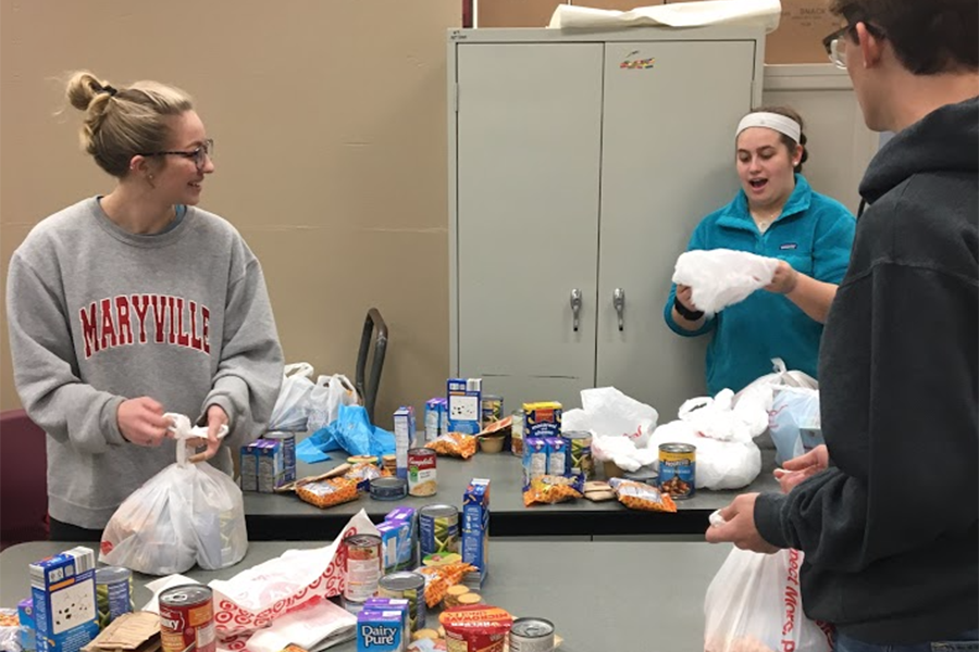 Maddie+Rose+Ortinau%2C+StuCo+president%2C+Declan+Ortinau+%289%29+and+Demi+Fine+%289%29+assemble+bags+for+Got+Your+Backpack+at+Fairway+Elementary%2C+March+8.