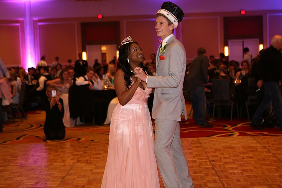 "Lonesha Phillips and Michael Molengraft (12), 2017 prom king and queen, share the first dance of the night, April 4. ""It was overwhelming; I wasn't expecting it. It was like I was on an emotional high. I was ecstatic,"" Phillips said. ""I actually cried when I won because I was excited and proud that people actually voted for me out of thousands of girls."""