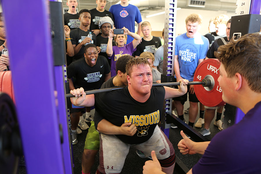"History in the making, Kurtis Winegardner (11) does a series of 550 LB squats to eventually become one of the now six kids to make the 1200 LB club in EHS's history during the football team's ""Night of Champions"" where everyone runs drills and lifts weights, May 17. ""I didn't feel anything because I couldn't feel my body. I was in a lot of pain probably, I don't remember it that well,"" Winegardner said. ""It felt great to have my teammates cheering me on because I knew they had my back. In the end I was proud of myself."""