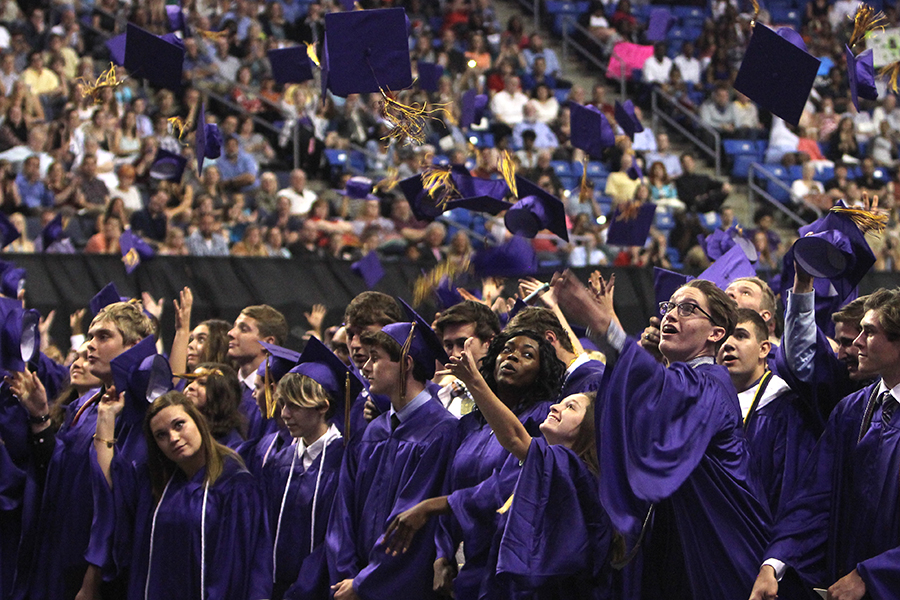 The Class of 2016 celebrates their graduation by tossing their mortar boards in the air at the end of their graduation ceremony, May 24, 2016.