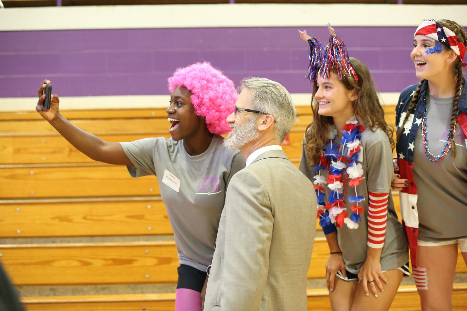 Superintendent in the building, Venie Holdengraver (12) snaps a selfie with Eric Knost alongside Sabriana Jung and Samantha MacGavin at Freshman Orientation, Aug. 11.