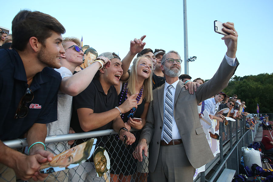 """He's on our side,"" Catpound chants as Christian Passiglia, Parker Nelson, Nick Livingston and Danielle Crooks (12) snap a selfie with Superintendent Eric Knost in the Catpound during the varsity football game against Lafayette, Sept. 15. ""I was excited to get a selfie with him because it is something everyone does,"" Crooks said. ""With my last year in the Catpound, I know that I'll miss it. I'm trying to enjoy it all while I can. I like to cheer for the team. It is exciting to be with everyone--just getting together with the whole senior class."" The Wildcats won, 28-14."