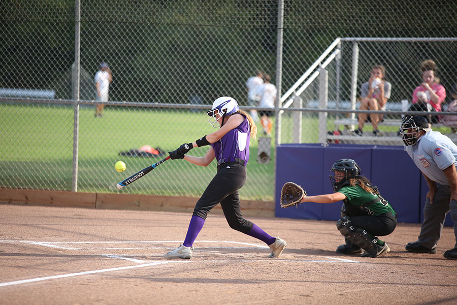"""Back in the swing, Adele Marrale,, first base, hits the ball past first scoring a run at the JV softball game against Mehlville, Sept 25. """"Mondays are usually hard for us as a team coming back from the weekend,"""" Marrale said. """"It took us an inning or two to get back into playing, but--once we did--we all played really well as a team and ended up mercy ruling them."""" The game was mercy ruled in the third inning. The Wildcats won, 15-0."""