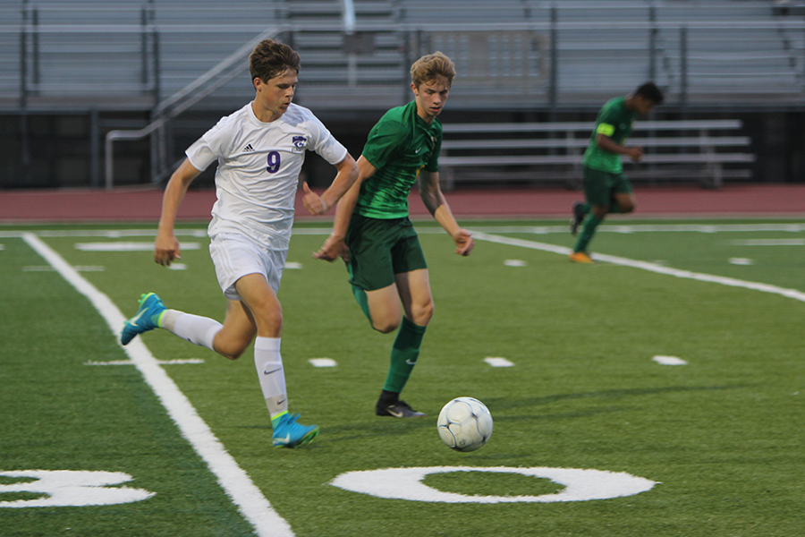 Mason Britt, midfield, charges the ball to maintain Eureka possession, Sept. 26. The Wildcats won, 2-1.