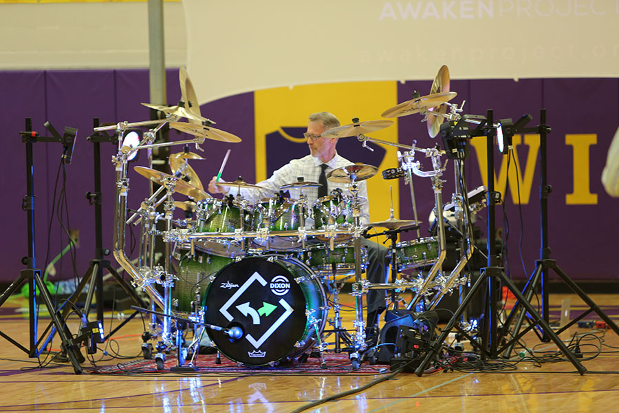 Superintendent Eric Knost treats the student body to a performance during the Awakening Project assembly that started off the first Student Health and Wellness day, Nov. 21, 2016. The second annual event will take place, Oct. 23.