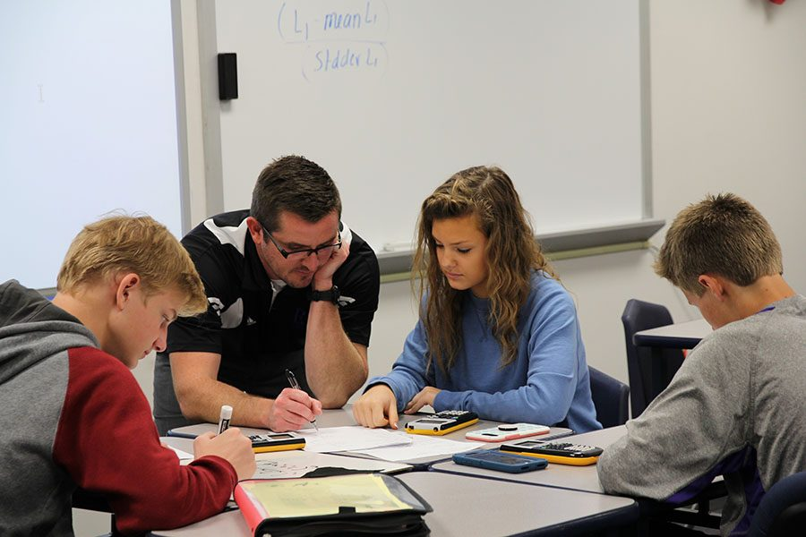 """Removing the radicals, Mallory Busby (9) looks for Michael Hanna's help during his second hour Building Algebra Mastery class, Oct.12. """"This isn't a class for me,"""" Busby said. """"There isn't any pressure, and the only thing you are focused on is learning. It is fun. I know this sounds dorky, but I look forward to going to math every day. Mr. Hanna is just such a good teacher: he never yells at me, and he makes me want to learn. My only focus is to learn, which isn't something I can always focus on in other classes."""""""