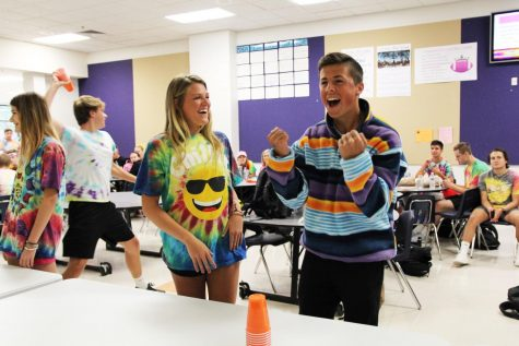 Cups stacked, Zoe Gustafson (11) and Nate Koenig (12) participate in lunchtime activities to earn points for the Junior class during Spirit Week, Oct. 3.