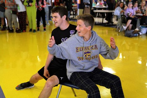 Checking for conformation of his win at musical chairs, Josh Jackson (12) makes sure the judges confirm his win after being hip checked by Ryan Schwentker (9) in order to win class points for lunchtime activities, Oct. 5