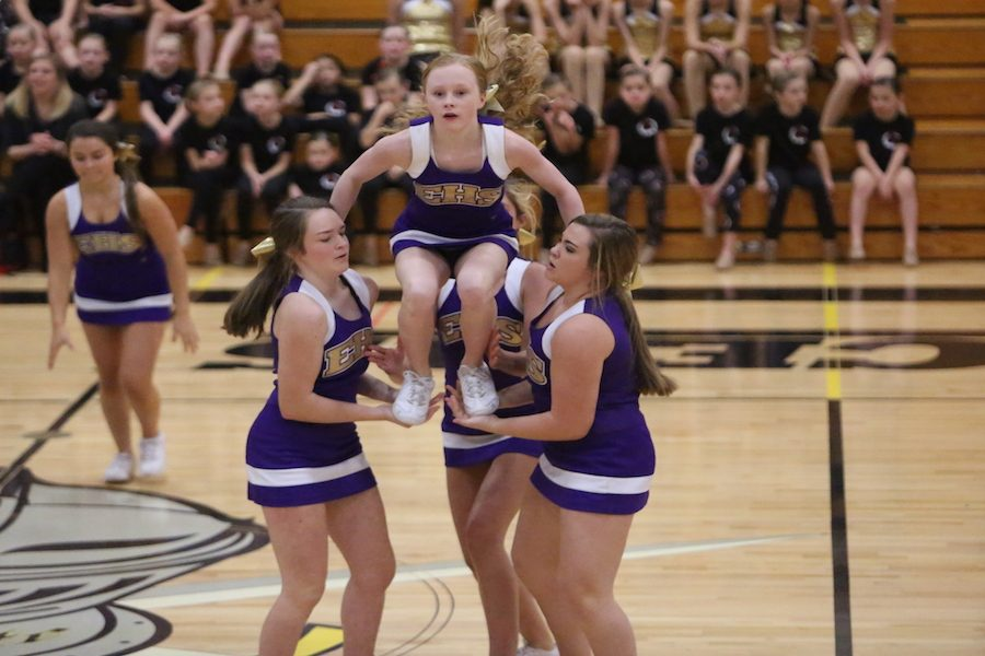 """Preparing for an extension, Kate Marshall (9) and Brooke Hayes (9) support Claire Seaborn (9) before she extends into a stunt during the Cheer for Charity fundraiser at Lafayette, Nov. 12. """"The Cheer for Charity fundraiser is one that cheer has participated in for a while,"""" Hayes (9) said. """"Each team performs for a crowd, who must pay to get in. The fundraiser raises a lot of money for the Ronald McDonald house and organization. It was a lot of fun and a great way to give back."""""""
