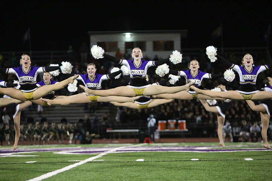 Jordan+Bee%2C+Stephanie+Lubinski%2C+and+Elle+Baker+%2812%29+hit+a+toe+touch+at+Golden+Line%E2%80%99s+halftime+performance+at+the+varsity+football+game+against+Lindbergh%2C+Nov.+3.+%E2%80%9CWhen+the+band+walks+off+the+field+it%27s+kind+of+like+our+stage%2C%E2%80%9D+Lubinski+said.+%E2%80%9CThe+lights+make+the+crowd+and+all+my+surrounds+blurry%2C+and+I+can+feel+the+energy+off+of+my+teammates.+The+anticipation+before+the+music+starts+builds+up%2C+surrounding+us.+When+we+start+dancing%2C+I+can+feel+our+energy+off+of+everyone.+I+enjoy+the+feeling+of+dancing+as+large+and+strong+as+I+can.+When+I+do+a+kick+or+a+trick+and+the+crowd+cheers%2C+it+pushes+me+to+stretch+my+legs+farther%2C+hit+my+moves+stronger+and+smile+bigger.+Overall%2C+I+enjoy+the+feeling+of+accomplishment+after+I++dance+because+of+how+hard+my+teammates+and+I+worked+to+construct+an+intricate+dance.%E2%80%9D