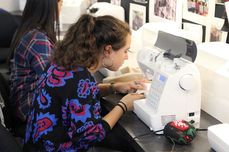 Focusing intensely on her sewing, Melanie Luczak (12) sews a pair of pajama pants in Debbie Powell's seventh hour Fashions 1 class, Nov. 11.
