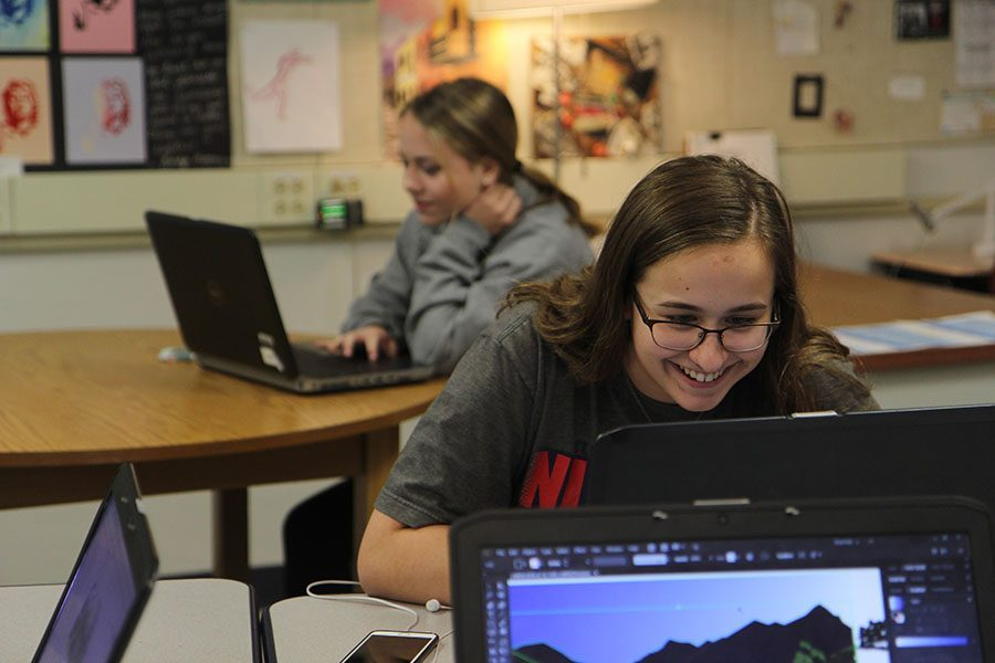 Typography+learned%2C+Emily+Holtzmann+%2811%29+finishes+her+project+about+America+on+a+laptop+using+Adobe+Illustrator+in+Diana+Bashirian%E2%80%99s+Graphic+Design+1+fifth+hour+class%2C+Nov.+29.+Next+year+the+district+will+issued+a+device+to+each+high+school+student.