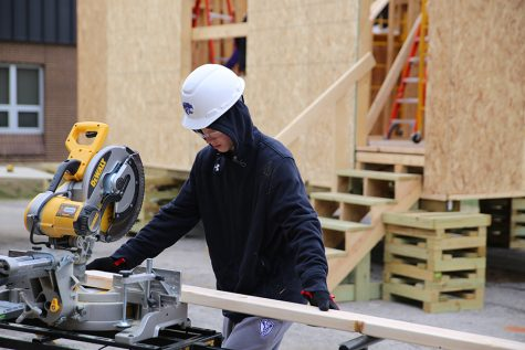 Winter temperatures don't stop Carson Estes (10)  from classwork as he cuts the rafters for the roof of a tiny home in Geometry in Construction, Dec. 14.