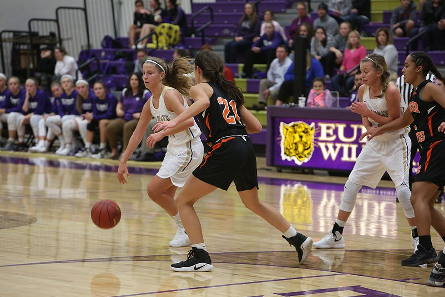 Up+against+a+challenge%2C+Annika+Herbert%2C+guard%2C+attempts+to+keep+the+lead+in+the+girls+varsity+basketball+game+against+Webster+Groves%2C+Dec.+5.+%E2%80%9CI+was+born+into+basketball%2C%E2%80%9D+Herbert+said.+%E2%80%9CMy+dad+has+always+been+a+coach%2C+and+my+brother+played+so+just+watching+it+and+then+playing+is+how+I+got+into+it.+I+have+always+loved+it.+It+is+fun+to+win%2C+but+practice+can+be+hard+work.+The+people+on+my+team+are+fun%2C+so+it+is+not+bad+to+work.%E2%80%9D+The+Wildcats+lost%2C+74-69.