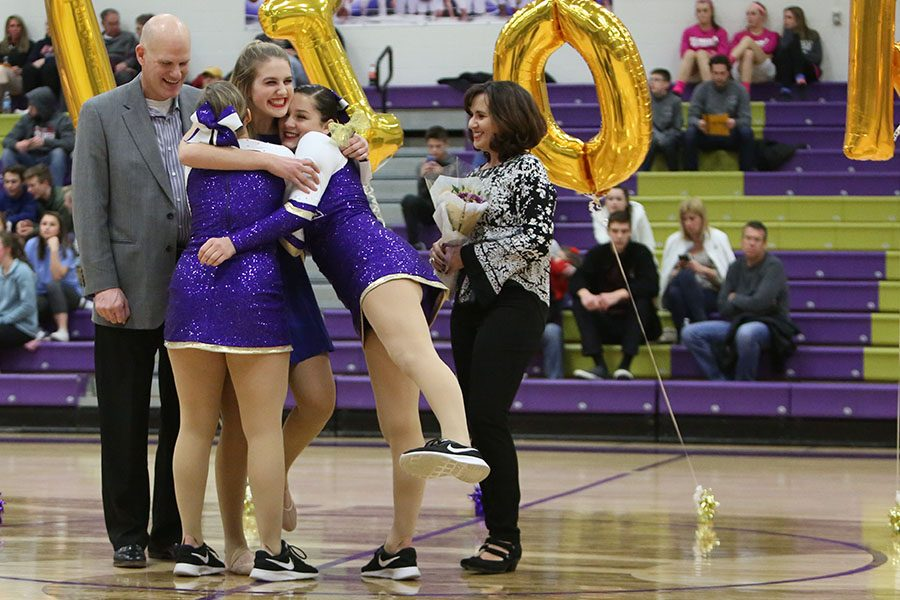 """Performances coming to an end, Kaitlyn Luft receives hugs from Sarah Emery and Lucy Trask to celebrate Golden Line's Senior Night, Jan.19. The seniors performed a special dance they choreographed to """"Bonfire Heart"""" by James Blunt. """"The most memorable moment for me was definitely performing our senior dance,"""" Luft said. """" I've been on the team with those six girls for four years, and they have become my closest friends. The night was bittersweet, but since it wasn't our last performance together I didn't feel too sad. It was more a sweet moment for me because just getting to perform with them still after four years is the best feeling ever. We still have three more competitions and some basketball games so our season isn't over yet. When it does end, I'll definitely be sad."""""""