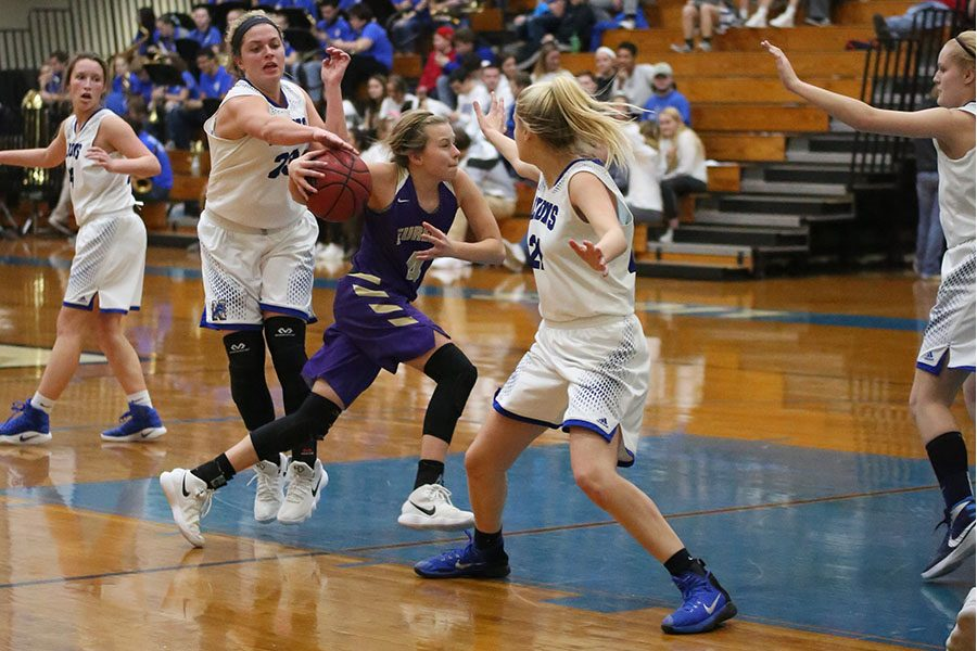 Katelyn+Hillyer%2C+shooting+guard%2C+dribbles+past+her+Northwest+opponent+at+the+girls+varsity+basketball+game%2C+Feb.+2.+%E2%80%9CWe+are+all+super+close%2C%E2%80%9D+Hillyer+said.+%E2%80%9CThe+seniors+are+so+good+about+keeping+everyone+included.+Everyone+loves+everyone%2C+which+makes+for+a+lot+of+fun+at+games+and+practice.+The+closeness+helps+in+games+because+we+are+able+to+communicate+better.+The+game+went+well.+We+played+as+a+team+and+were+able+to+finish+with+a+win.+We+definitely+made+some+mistakes%2C+but+we+pulled+it+out+as+a+team.+I+have+some+of+the+most+amazing+teammates%2C+and+I+think+that%27s+how+we+have+been+having+such+great+success.%E2%80%9D+The+Wildcats+won%2C+61+to+41.+
