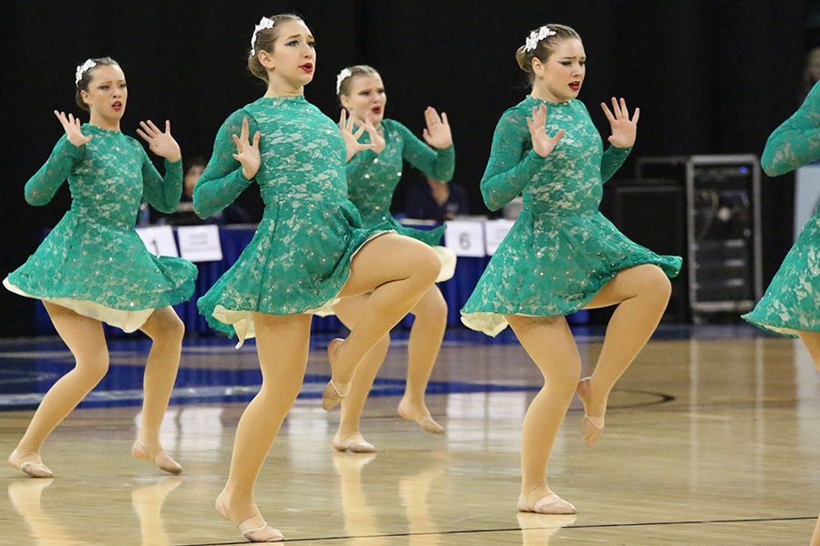 "Last competition of the year, Jacqueline Osias, Jensen Bee, Sarah Emery, and Jordan Bee perform with the rest of Golden Line during the state competition at the Family Arena in St. Charles, Feb. 24. ""It was incredible,"" Jensen Bee said. ""The competition was so hard because Class 6 is so competitive. We went into the weekend having absolutely no idea how we would do, at least that is how it was for me. We performed better than I could have imagined and everything hit, so we knew even if we didn't place as well as we hoped, we were happy with our performances. That's what counted. Second was just the cherry on top for an already-amazing year with such a dedicated team, and I'm overjoyed by the outcome."" The Golden Line placed first for Pom, third for Lyrical and second overall. Elle Baker placed second for senior soloist, Monica Zesch placed first in sophmore soloist and Katie Musgraves placed fourth in sophomore soloist."