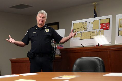With open arms, Michael Wiegand, Chief of police, discusses plans for a new justice center, Feb. 8.