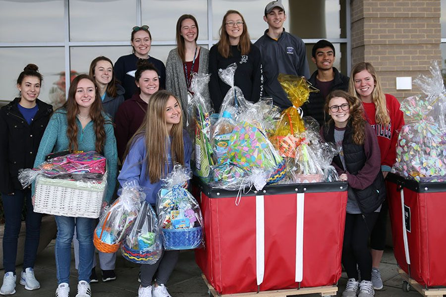 "Giving back to the community, NHS students pose at Cardinal Glennon Children's Hospital with the Easter baskets they created and donated, March 30. ""My back seat was stacked with baskets and my trunk was filled to the brim,"" Julia Wizeman (11) said. ""The nurses who picked up everything from us were so excited for the kids. Everyone I came into contact with that whole day was super grateful. It was cool to be able so see the impact that someone can have on someone they've never even met. I would love to experience something like that again. Next year, I hope that the officers can rally everyone into making even more so we can impact more kids on Easter."""