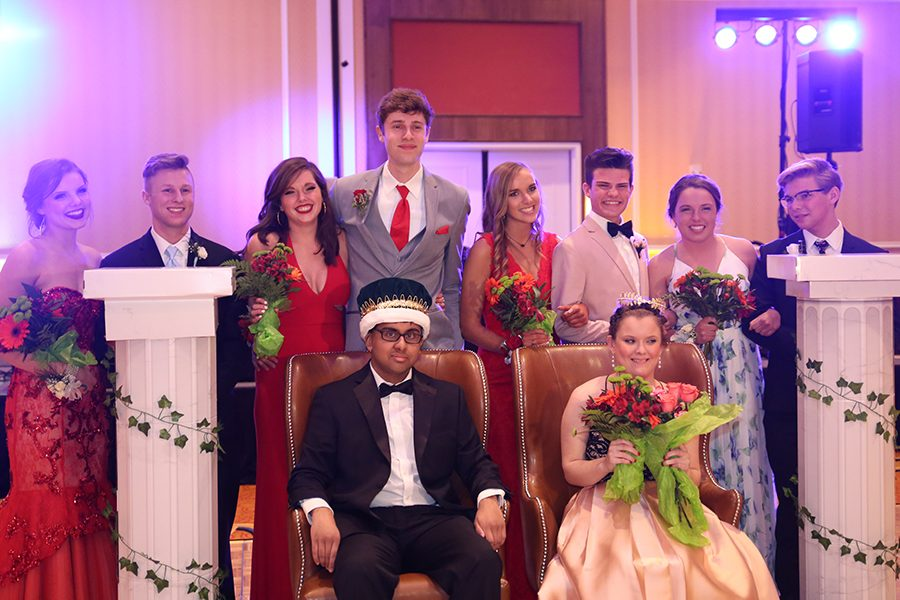"""King and queen crowned, (Front row) Rohan Rai, Prom king, and Jessica Nuckolls (12), Prom queen. (Back row) Shilee Hessman, Mitchell Gabel (11), Katie Meyerkord, William Boulay, Madelyn Hibbard, Jerod Turner (12), Anna Grimshaw, and Jonah DeBeir (11) pose for a photo at Prom, April 6th. """"It was so cool,"""" Rai said. """"It is a great feeling to know that people thought so highly of you that they would vote you to be king. I didn't expect it. I thought I had a small chance, probably 33 percent. It was a bit of a shock. On the actually Prom, I had a fever and felt sick. I didn't get to stay long, but I still had fun."""""""
