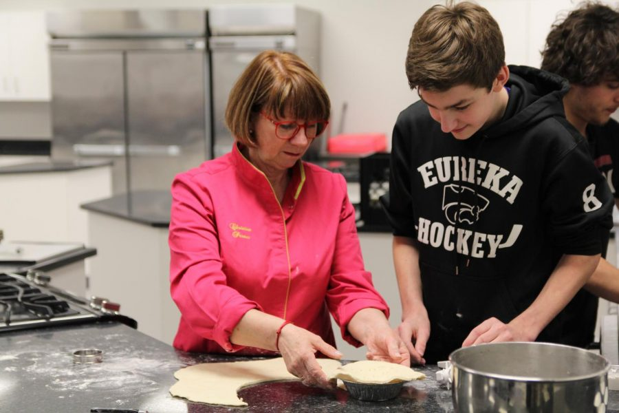 Jacob Fenn (10) works with Christine Pereur, pastry chef at Comme à la Maison / Like Home Café & Brasserie, to create pastries in a demonstration to French students, April 16.