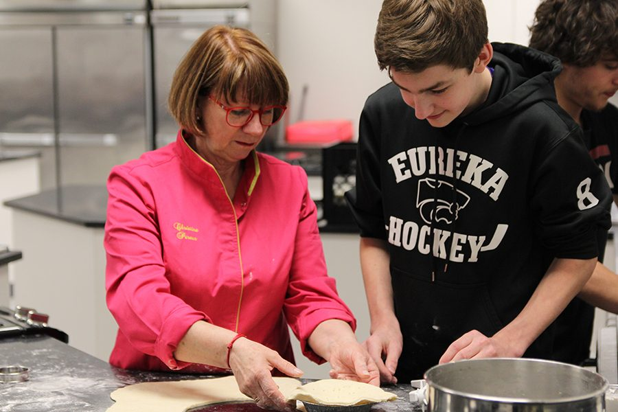 "Learning about culture, Christine Pereur, pastry chef at Comme à la Maison / Like Home Café & Brasserie, teaches Jacob Fenn (10) how to create pastries in a demonstration to French students, April 16. ""It was interesting,"" Fenn said. ""In a normal classroom setting, it gets old. In a setting like that, working with someone who has been to France, it allows you to identify differences in culture that help you learn. It is a cool comparison. An experience like this doesn't happen often."""