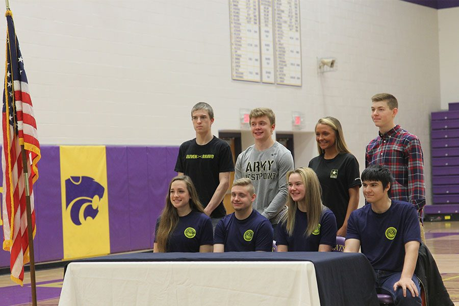 """Future in sight, (front row) Molly Kerr, Robert Gentry, Hannah Uffman, Alexander Young, (back row),  Austin  Neustaedter, Adam Fuqua, Kylee Bowling, and Nicholas Cunningham sign into the Army, Navy, and West Point Military Academy during Eureka's first ever military signing, April 9. """"I grew up watching my dad serve our country through the Navy and saw how positively it affected my family and the people around me,"""" Kerr said. """"With benefits like free college, retirement, and the honor of serving completely outweigh missing a couple of holidays and made it an easy decision to join. Since my dad and brother have been through the Navy, I know what to expect, so that eases the nerves. I do have a really mentally and physically tough job, however which is exciting but a little freaky."""""""