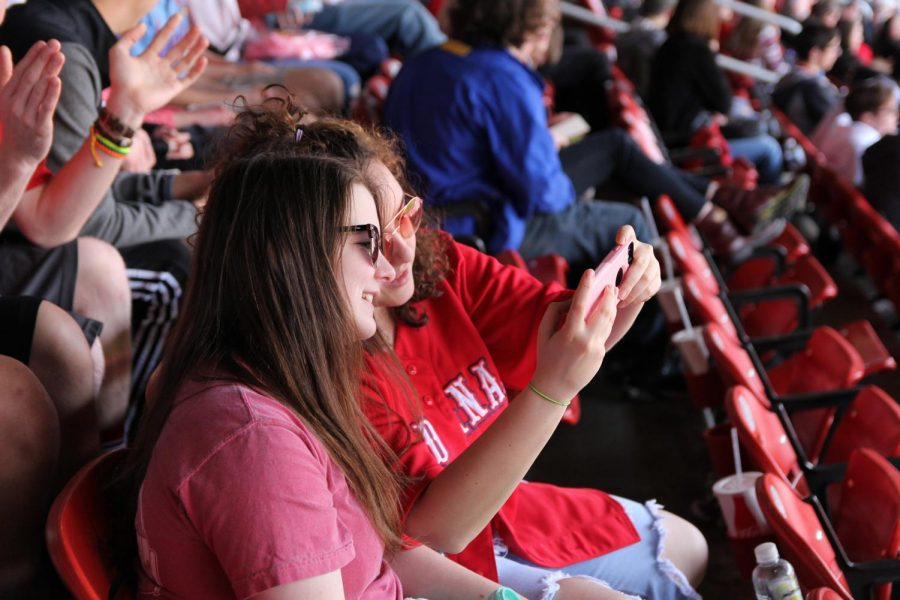 Jordyn Hammel and Sarah Guardia (12) pause for a selfie at at Bush Staduim during the senior class field trip, Apr. 11.