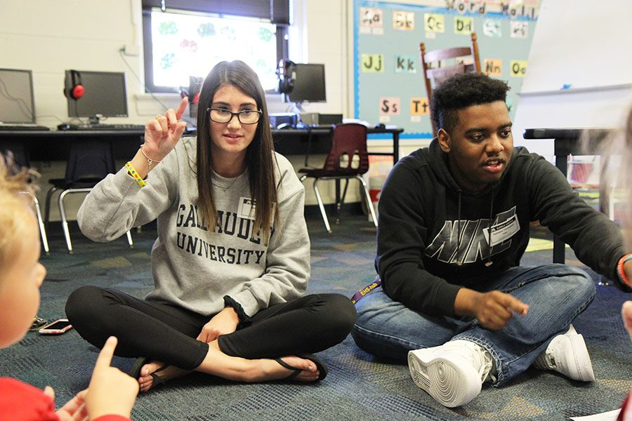 Alex DiPalma (12) and Dameion Thompson (11) help elementary school students to learn American Sign Language at Eureka Elementary, Oct. 17.