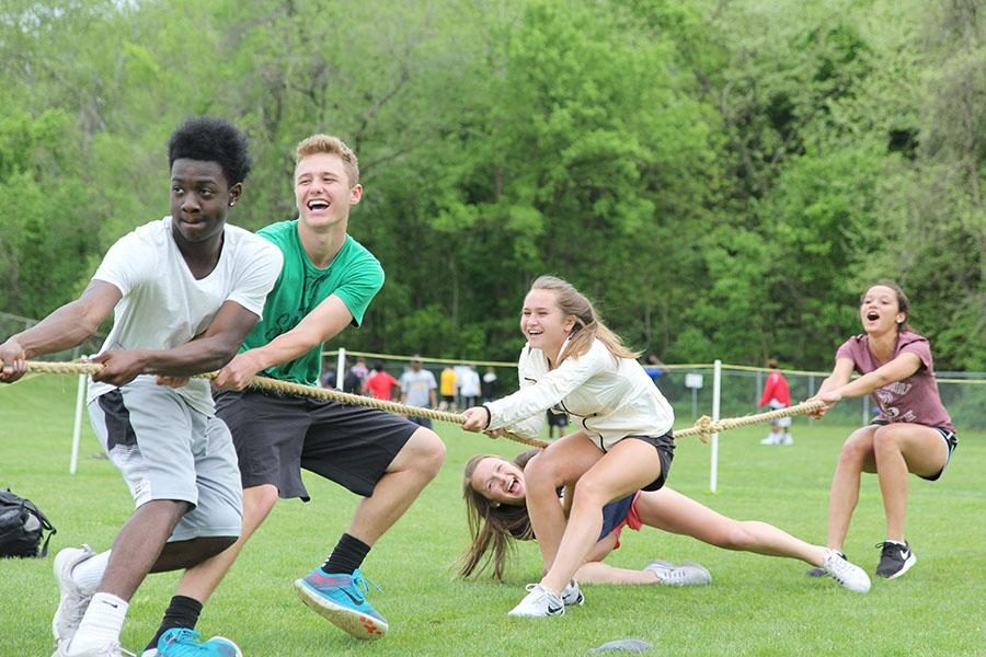 Norrim Holder (11), Michael Orso (11), Sara Mocker (10), Hayley Jakovich (10), and Cameron Robinson (10) play tug of war, April 29, 2016. Students can take a break from academics by playing games and hanging out at the Rally.