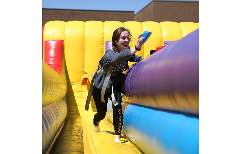 "Mackenzie Goode (11) participates in a game during the Renaissance Carnival, April 27. ""I enjoyed the great weather,"" Goode said. ""It made the day even more fun. I loved that my friends and I could do all those activities like the bouncy houses or tug of war while enjoying a lovely day. When we went to the award ceremony to highlight our achievements, it felt like our hard work was shown off. It was great to see all my friends get awards alongside me. It made me feel good to have those achievements recognized and being rewarded with a break from school. The carnival is a great day. Some people leave school and miss out, but then they miss a fun day that is less stressful than a normal school day."""